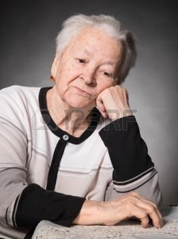 20172874-old-thoughtful-woman-on-a-gray-background.jpg